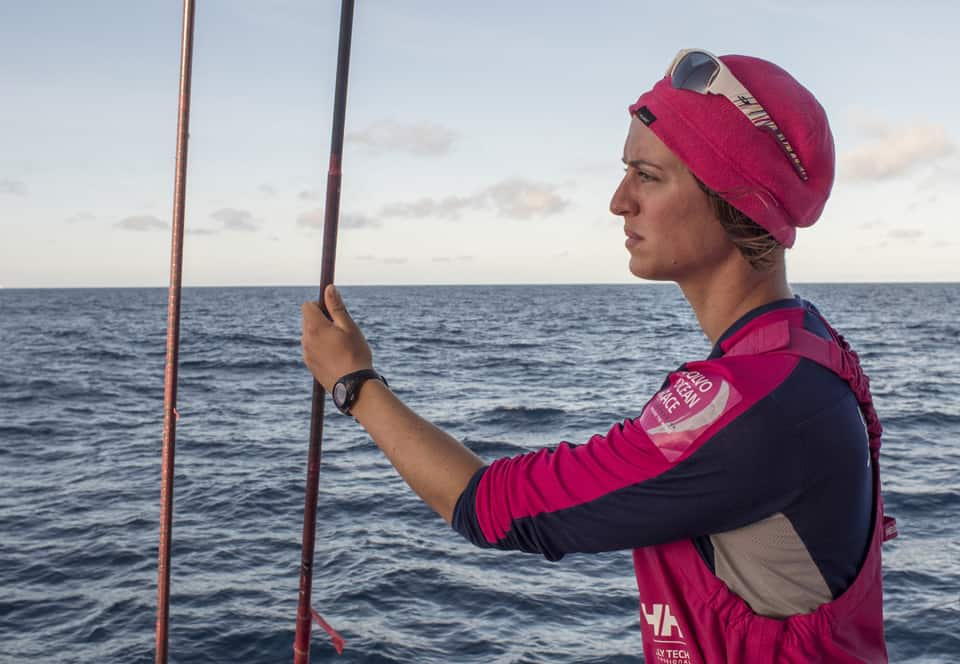 October 15, 2014. Leg 1 onboard Team SCA: Justine Mettraux watches the other boats for any tactical manoeuvre
